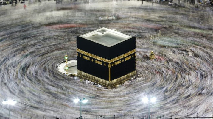 FILE - In this Aug. 13, 2019, file photo taken with a slow shutter speed, Muslim pilgrims circumambulate the Kaaba, the cubic building at the Grand Mosque, during the hajj pilgrimage in the Muslim holy city of Mecca, Saudi Arabia. Saudi Arabia on Thursday, Feb. 27, 2020, halted travel to the holiest sites in Islam over fears of the global outbreak of the new coronavirus just months ahead of the annual hajj pilgrimage, a move coming as the Mideast has over 220 confirmed cases of the illness. (AP Photo/Amr Nabil, File)