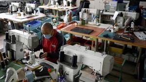 FOTO: Manufaktur China Bangkit Walau Virus Corona Melanda