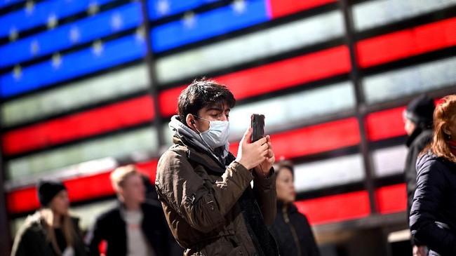 Jumlah kasus infeksi virus corona di Amerika Serikat tercatat mencapai 1.037 kasus dengan 31 kematian, pada Rabu (11/3). (Photo by Johannes EISELE / AFP)