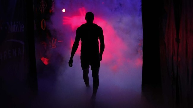 Atlet Washington State, Jervae Robinson, berlari ke lapangan sebelum pertandingan NCAA melawan Colorado. (AP Photo/John Locher)