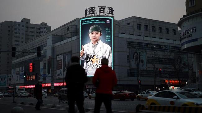 Pada Jumat (27/3) hanya tercatat penambahan satu kasus di Wuhan. (Photo by STR / AFP) / China OUT