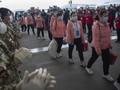 China Cabut Lockdown, Ribuan Warga Bergegas Tinggalkan Wuhan
