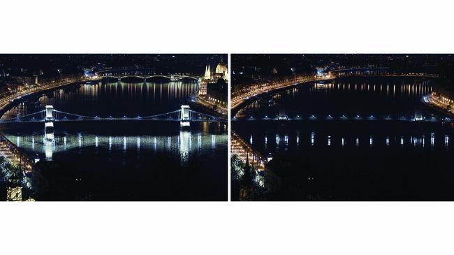 Jembatan di Budapest dihiasi lampu berwarna putih pada Hari Bumi untuk menghormati para dokter, perawat, dan petugas medis lainnya yang tengah berjuang melawan pandemi Virus Corona COVID-19. (ATTILA KISBENEDEK / AFP)