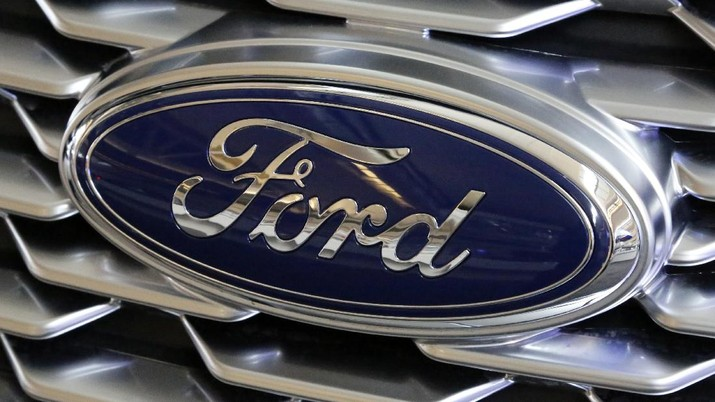 FILE - This Feb. 15, 2018 photo shows a Ford logo on display at the Pittsburgh Auto Show in Pittsburgh. Ford is recalling more than 268,000 cars in North America, on Wednesday, March 25, 2020  to fix doors that could open unexpectedly or may not close. The recall covers the 2014 through 2016 Ford Fusion and Lincoln MKZ, and the 2014 and 2015 Ford Fiesta.  (AP Photo/Gene J. Puskar)