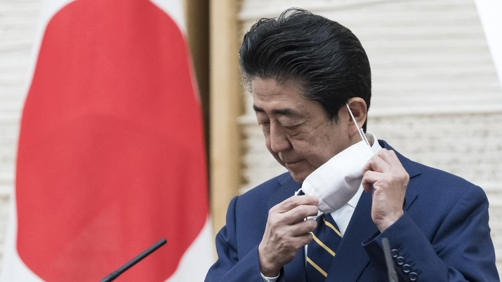 Japan's Prime Minister Shinzo Abe gestures during a press conference at the prime minister's official residence Tuesday, April 7, 2020, in Tokyo. Abe declared a state of emergency for Tokyo and six other prefectures to ramp up defenses against the spread of the coronavirus. (Tomohiro Ohsumi/Pool Photo via AP)