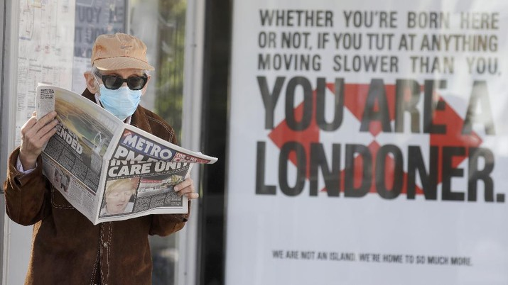 A man reads a newspaper with the headline: 'PM in intensive care', outside St Thomas' Hospital in central London as British Prime Minister Boris Johnson is in intensive care fighting the coronavirus in London, Tuesday, April 7, 2020. Johnson was admitted to St Thomas' hospital in central London on Sunday after his coronavirus symptoms persisted for 10 days. Having been in hospital for tests and observation, his doctors advised that he be admitted to intensive care on Monday evening. The new coronavirus causes mild or moderate symptoms for most people, but for some, especially older adults and people with existing health problems, it can cause more severe illness or death.(AP Photo/Kirsty Wigglesworth)