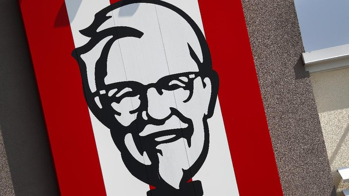 In this photo taken Tuesday, July 30, 2019, a sign outside a Kentucky Fried Chicken restaurant in Conyers, Ga.is shown. (AP Photo/John Bazemore)