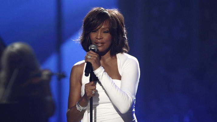 "FILE - In this Nov. 22, 2009 file photo, Whitney Houston performs at the 37th Annual American Music Awards in Los Angeles. A feature film about Houston's life is in the works from Anthony McCarten, the screenwriter of ""Bohemian Rhapsody."" The biopic is being shepherded by the Whitney Houston Estate, music producer Clive Davis and Primary Wave Music, the partners said Wednesday. (AP Photo/Matt Sayles)"