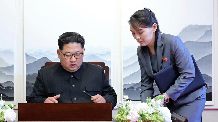 FILE - In this April 27, 2018, file photo, North Korean leader Kim Jong Un signs a guestbook next to his sister Kim Yo Jong, right, inside the Peace House at the border village of Panmunjom in Demilitarized Zone. With North Korea saying nothing so far about outside media reports that leader Kim Jong Un may be unwell, there's renewed worry about who's next in line to run a nuclear-armed country that's been ruled by the same family for seven decades. (Korea Summit Press Pool via AP, File)