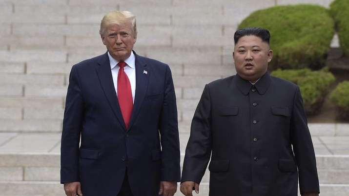 "FILE- In this June 30, 2019 file photo, President Donald Trump, left, meets with North Korean leader Kim Jong Un at the North Korean side of the border at the village of Panmunjom in Demilitarized Zone. North Korea on Sunday dismissed as ""ungrounded"" President Donald Trump's comment that he recently received ""a nice note"" from the North's leader, Kim Jong Un.