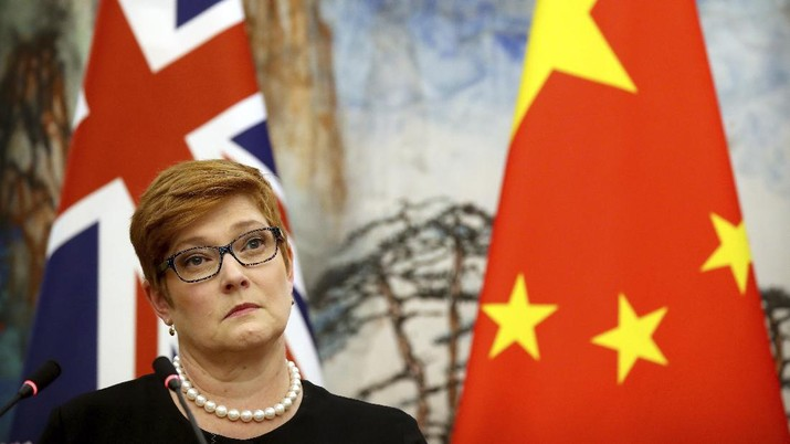 Australian Foreign Minister Marise Payne listens to a reporter's question during a joint press conference with Chinese Foreign Minister Wang Yi at the Diaoyutai State Guesthouse in Beijing, Thursday, Nov. 8, 2018. The foreign ministers of China and Australia are meeting in what is being seen as a sign of a thaw in the recently frosty relationship between the key economic partners. (AP Photo/Mark Schiefelbein)