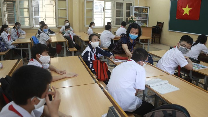 Students wearing masks attend a class in Dinh Cong secondary school in Hanoi, Vietnam Monday, May 4, 2020. Students across Vietnam return to school after three months of studying online due to school closure to contain the spread of COVID-19. (AP Photo/Hau Dinh)