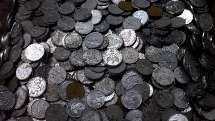 In this Saturday, May 2, 2020, photo, rupiah coins are seen inside a donation box for animals at Medan Zoo which is affected by the new coronavirus outbreak at a collection point n Medan, North Sumatra, Indonesia. It has been more than a month since the zoo closed for visitors as part of efforts to stop the spread of the coronavirus. With no income to buy food for the animals, the management appealed for outside help. (AP Photo/Binsar Bakkara)