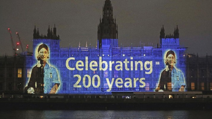 An image of Florence Nightingale is projected on the Houses of Parliament in Westminster, London, on International Nurses Day and to mark the 200th anniversary of the birth of the nurse, Tuesday, May 12, 2020. Historians have praised Florence Nightingale on the 200th anniversary of her birth, and said her legacy has