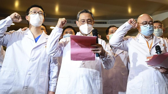 In this March 2, 2020 photo released by Xinhua News Agency, renowned Chinese respiratory specialist Zhong Nanshan attends an oath-taking ceremony via video connections for two new probationary Communist Party members in Wuhan to take the oath of joining the Communist Party of China, in Guangzhou, southern China's Guangdong Province. As the rest of the world grapples with a burgeoning virus outbreak, China's ruling Communist Party has turned to its propaganda playbook to portray its leader as firmly in charge, leading an army of health workers in a