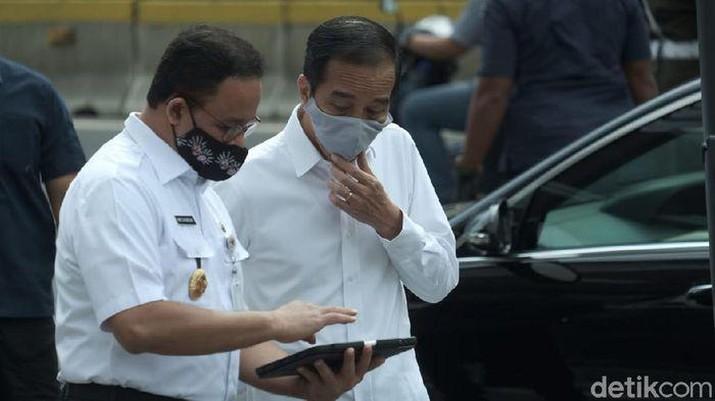 Presiden Jokowi bersama Anies Baswedan. (Andika Prasetia/detikcom).