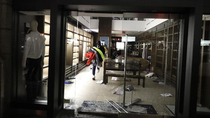 Penjarahan di Amerika Serikat. AP/Seth Wenig