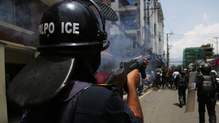 Nepalese police use water cannon to disperse youth who gathered for a protest near prime minister's residence demanding better handling of the COVID-19 pandemic in Kathmandu, Nepal, Thursday, June 11, 2020. About 1000 protesters had gathered demanding increased testing and alleging corruption by government officials while purchasing equipment and testing kits. (AP Photo/Niranjan Shrestha)