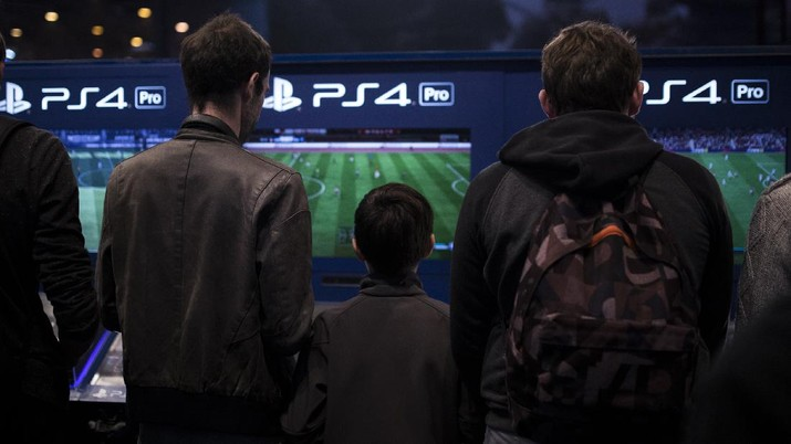 The logo of home video game console PS4 is pictured at the Paris games week in Paris, Saturday, Nov. 4, 2017. (AP Photo/Christophe Ena)