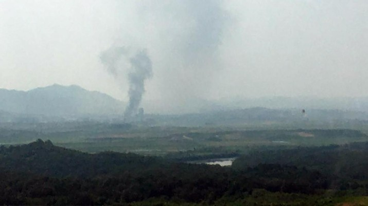 Smoke raising in the North Korean border town of Kaesong is seen from Paju, South Korea, Tuesday, June 16, 2020. North Korea blew up an inter-Korean liaison office building just inside its border in an act Tuesday that sharply raises tensions on the Korean Peninsula amid deadlocked nuclear diplomacy with the United States. (Yonhap via AP)