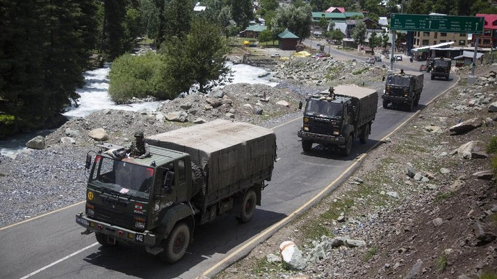 An Indian army soldier guards atop one of the vehicles as an army convoy moves on the Srinagar- Ladakh highway at Gagangeer, north-east of Srinagar, India, Wednesday, June 17, 2020. Indian security forces said neither side fired any shots in the clash in the Ladakh region late Monday that was the first deadly confrontation on the disputed border between India and China since 1975. China said Wednesday that it is seeking a peaceful resolution to its Himalayan border dispute with India following the death of 20 Indian soldiers in the most violent confrontation in decades. (AP Photo/Mukhtar Khan)
