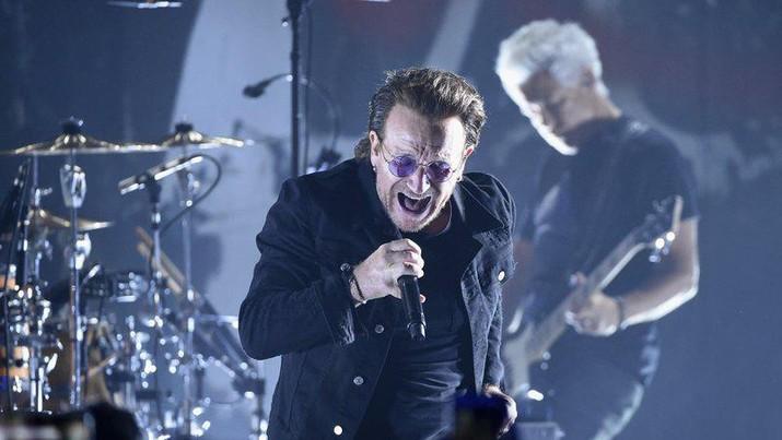 Konser U2/Evan Agostini/Invision/AP, File)