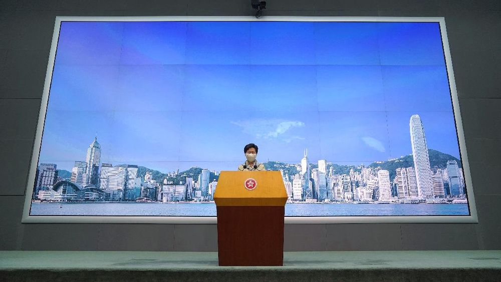Hong Kong Chief Executive Carrie Lam listens to reporter's question during a press conference in Hong Kong, Tuesday, June 30, 2020. Hong Kong media are reporting that China has approved a contentious law that would allow authorities to crack down on subversive and secessionist activity in Hong Kong, sparking fears that it would be used to curb opposition voices in the semi-autonomous territory.(AP Photo/Vincent Yu)