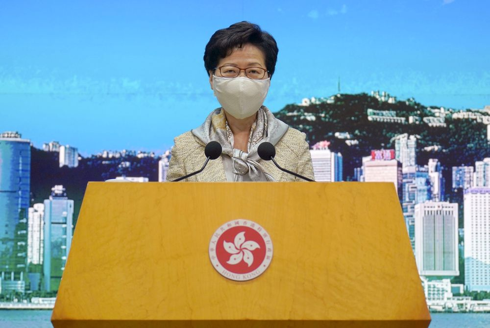 """Hong Kong Chief Executive Carrie Lam listens to reporters' questions during a press conference in Hong Kong, Tuesday, June 30, 2020.  Hong Kong media are reporting that China has approved a contentious law that would allow authorities to crack down on subversive and secessionist activity in Hong Kong, sparking fears that it would be used to curb opposition voices in the semi-autonomous territory. Lam declined to comment on the national security law at a weekly meeting with reporters, saying it was """"inappropriate"""" for her to do so while the Standing Committee meeting was still in progress.(AP Photo/Vincent Yu)"""