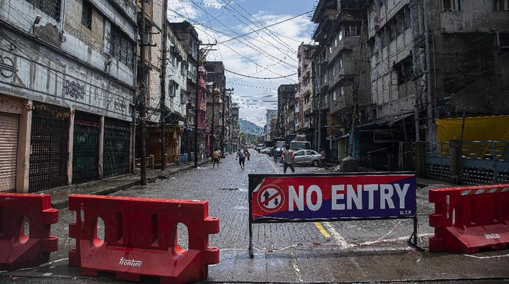 Indian youngsters play cricket in barricaded street during the reimposed lockdown in Gauhati, India, Monday, June 29, 2020. India has reported a new daily record of nearly 20,000 new infections as several Indian states reimpose partial or full lockdowns to stem the spread of the coronavirus. (AP Photo/Anupam Nath)