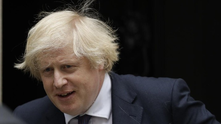 British Prime Minister Boris Johnson leaves 10 Downing Street in London, to attend the weekly Prime Minister's Questions at the Houses of Parliament, in London, Wednesday, July 1, 2020. (AP Photo/Matt Dunham)
