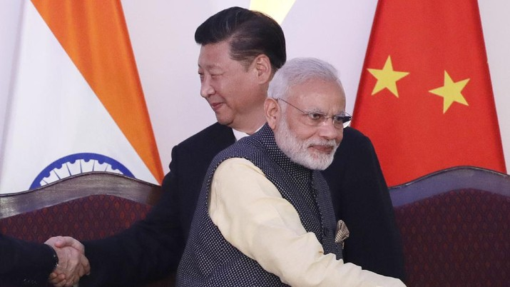 In this Oct. 16, 2016, file photo, Indian Prime Minister Narendra Modi, front and Chinese President Xi Jinping shake hands with leaders at the BRICS summit in Goa, India. Modi made an unannounced visit Friday, July 3, 2020, to a military base in remote Ladakh region bordering China where the soldiers of the two countries have been facing off for nearly two months. Modi's visit comes in the backdrop of massive Indian army build-up in Ladakh region following hand-to-hand combat between Indian and Chinese soldiers on June 15 that left 20 Indian soldiers dead and dozens injured, the worst military confrontation in over four decades between the Asian giants. (AP Photo/Manish Swarup, File)