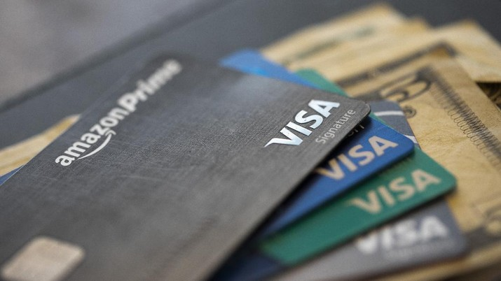 This Aug. 11, 2019 file photo shows credit cards in New Orleans. U.S. consumer borrowing plunged in April as households fretted about the disruptions caused by the coronavirus pandemic and cut back on their use of credit. The Federal Reserve reported Friday, June 5, 2020 that total borrowing fell by $68.8 billion, or 19.6%. That was the biggest one-month decline in percentage terms since the end of World War II. (AP Photo/Jenny Kane, file)