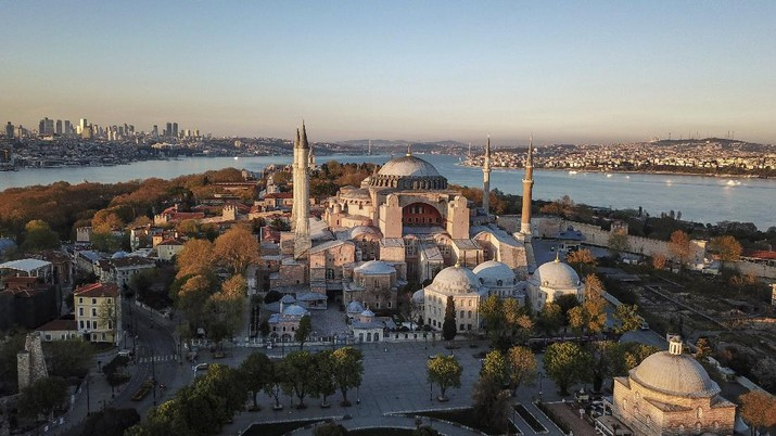 FILE-In this Saturday, April 25, 2020 file photo, an aerial view of the Byzantine-era Hagia Sophia, one of Istanbul's main tourist attractions in the historic Sultanahmet district of Istanbul.Turkey's Council of State on Friday, July 10, 2020, threw its weight behind a petition brought by a religious group and annulled a 1934 cabinet decision that changed the 6th century building into a museum. The ruling allows the government to restore the Hagia Sophia's previous status as a mosque.The decision was in line with the Turkish President's Recep Tayyip Erdogan's calls to turn the hugely symbolic world heritage site into a mosque despite widespread international criticism, including from the United States and Orthodox Christian leaders. (AP Photo)