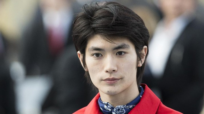 Japanese actor and singer Haruma Miura attends the Louis Vuitton men's Fall-Winter 2014-2015 fashion collection, presented Thursday, Jan. 16, 2014 in Paris. (AP Photo/Jacques Brinon)