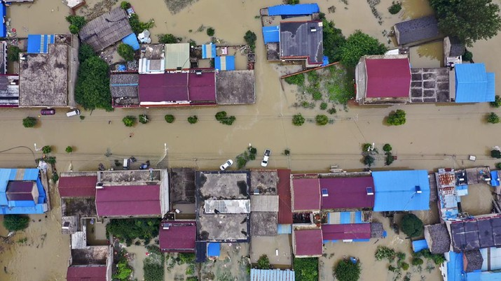In this photo released by Xinhua News Agency, an aerial photo shows the extent of flooding in Guzhen Town of Lu'an City in eastern China's Anhui Province on Monday, July 20, 2020. (Tang Yang/Xinhua via AP)