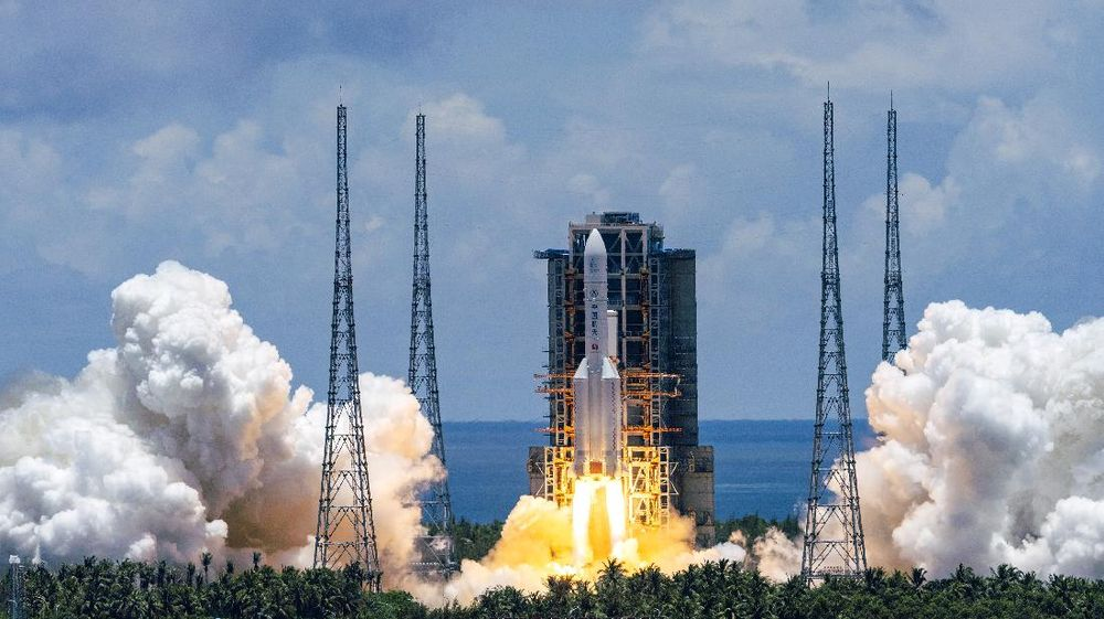 In this photo released by China's Xinhua News Agency, a Long March-5 rocket carrying the Tianwen-1 Mars probe lifts off from the Wenchang Space Launch Center in southern China's Hainan Province, Thursday, July 23, 2020. China launched its most ambitious Mars mission yet on Thursday in a bold attempt to join the United States in successfully landing a spacecraft on the red planet. (Cai Yang/Xinhua via AP)