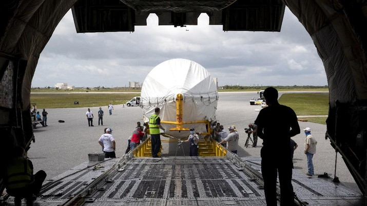 In this view from inside the Antonov 124 cargo aircraft, the United Launch Alliance booster for NASA's Mars Perseverance rover is offloaded at the Skid Strip at Cape Canaveral Air Force Station (CCAFS) in Florida on May 19, 2020. The Mars Perseverance rover is scheduled to launch in mid-July atop a United Launch Alliance Atlas V 541 rocket from Pad 41 at CCAFS. The rover is part of NASA's Mars Exploration Program, a long-term effort of robotic exploration of the Red Planet. The rover will search for habitable conditions in the ancient past and signs of past microbial life on Mars. The Launch Services Program at Kennedy is responsible for launch management.