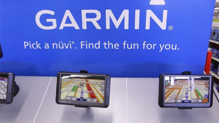 In this photo taken Monday, Aug. 24, 2009, Garmin GPS navigation devices are displayed at the Staples Office Supply store in Springfield, Ill., . (AP Photo/Seth Perlman)