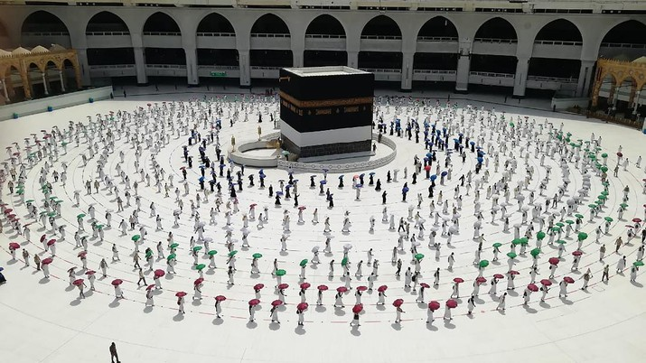 Hundreds of Muslim pilgrims circle the Kaaba, the cubic building at the Grand Mosque, as they keep social destination to protect themselves against the coronavirus ahead of the Hajj pilgrimage in the Muslim holy city of Mecca, Saudi Arabia, Wednesday, July 29, 2020. During the first rites of hajj, Muslims circle the Kaaba counter-clockwise seven times while reciting supplications to God, then walk between two hills where Ibrahim's wife, Hagar, is believed to have run as she searched for water for her dying son before God brought forth a well that runs to this day. (AP Photo)