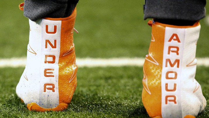 """FILE- In this March 5, 2017, file photo a closeup of Under Armour cleats are seen before a drill at the 2017 NFL football scouting combine in Indianapolis. Under Armour received a warning from U.S. regulators that the company and two executives could be punished over past accounting practices. The sporting goods company said in a government filing Monday, July 27, 2020, that the warning, known as a """"Wells Notice,"""" was sent last week from the U.S. Securities and Exchange Commission.  (AP Photo/Gregory Payan, File)"""