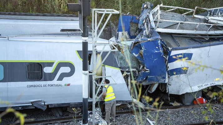 A broken window in a passenger car of an intercity train after it rammed into a maintenance vehicle on the track in Soure, northern Portugal, Friday, July 31, 2020. Two workers in the maintenance vehicle were killed and several passengers in the train were seriously injured. (AP Photo/Sergio Azenha)