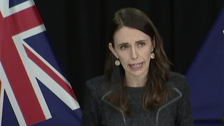 In this image from a video, New Zealand Prime Minister Jacinda Ardern speaks at a news conference in Wellington, New Zealand Tuesday, Aug. 11, 2020. Ardern said Tuesday that authorities have found four cases of the coronavirus in one Auckland household from an unknown source, the first reported cases of local transmission in the country in 102 days. (TVNZ via AP)