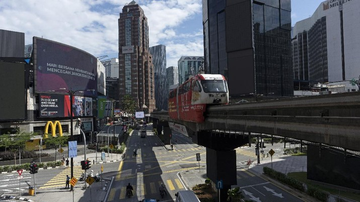 A monorail moves through empty shopping district in downtown Kuala Lumpur, Malaysia, on Monday, May 4, 2020. Many business sectors reopened Monday in some parts of Malaysia since a partial virus lockdown began March 18. The easing of restrictions, days before the lockdown was due to end May 12, came as Prime Minister Muhyiddin Yassin's government sought to balance between curbing the virus and reviving the hard-hit economy.(AP Photo/Vincent Thian)