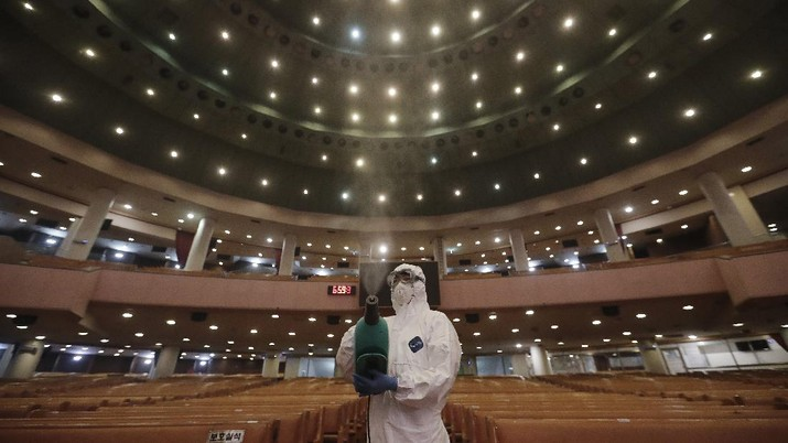 A public official disinfects as a precaution against the coronavirus at the Yoido Full Gospel Church in Seoul, South Korea, Friday, Aug. 21, 2020. South Korea's Centers for Disease Control and Prevention on Friday reported new infections from practically all major cities nationwide, including Busan, Gwangju, Daejeon, Sejong and Daegu, a southeastern city that was the epicenter of a massive outbreak in late February and March. (AP Photo/Ahn Young-joon)