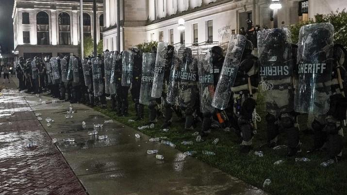 Unjuk rasa gerakan Black Lives Matter terkait dengan insiden penembakan masyarakat kulit hitam oleh polisi di beberapa negara bagian di Amerika Serikat kembali memanas. AP/Morry Gash