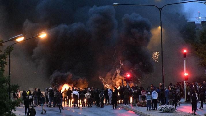 Demo membakar Alquran di kota Malmo, Swedia selatan. (AP/TT)