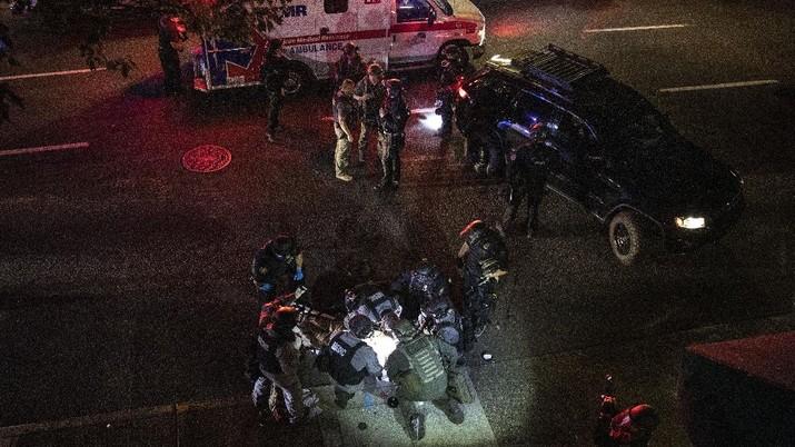 Satu orang tewas tertembak mati di Portland, Oregon, Amerika Serikat. (AP/Paula Bronstein)