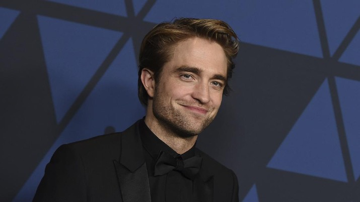 "FILE - This Oct. 27, 2019 file photo show actor Robert Pattinson at the Governors Awards in Los Angeles. Warner Bros. is delaying a batch of releases including ""The Batman"" and ""The Sopranos"" prequel ""The Many Saints of Newark."" The studio said Monday, April 20, 2020 that ""The Sopranos"" film will be pushed from September 2020 to a March 2021 release, while ""The Batman"" starring Pattinson will be delayed four months to October 2021.  (Photo by Jordan Strauss/Invision/AP, File)"