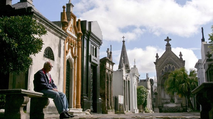 A man rests on a bench at the Recoleta cemetery in Buenos Aires, Argentina. The cemetery includes graves of some of the most influential people of Argentina, including several presidents, scientists and Eva Peron. (AP Photo/Natacha Pisarenko)