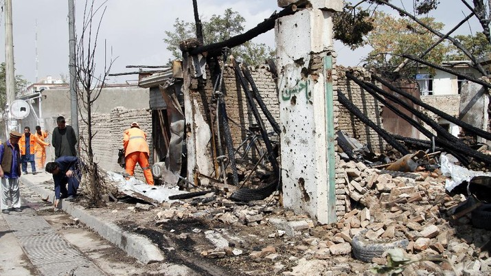 Afghan municipality workers clear debris at the site of an explosion in Kabul, Afghanistan, Wednesday, Sept. 9, 2020. Spokesman for Afghanistan's Interior Ministry said the bombing that targeted the convoy of the country's first vice president on Wednesday morning killed several people and wounded more than a dozen others, including several of the vice president's bodyguards. (AP Photo/Rahmat Gul)